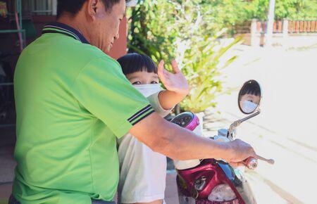 Grandfather took grandson go to market and wear white mask to protect coronavirus ( covid-19 ) Banco de Imagens
