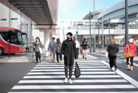 Man wear black mask to protect covid-19 virus and travel in big city and go back home