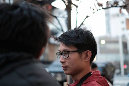 Close up young asian boy in big city and student college go to school concept