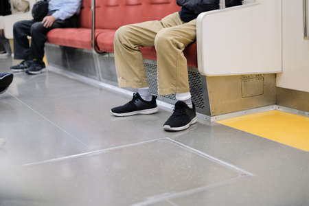 Social distancing between seat on subway train and people go to work and travel concept