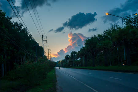 Sunset sky with motorcycles on trang-palian road