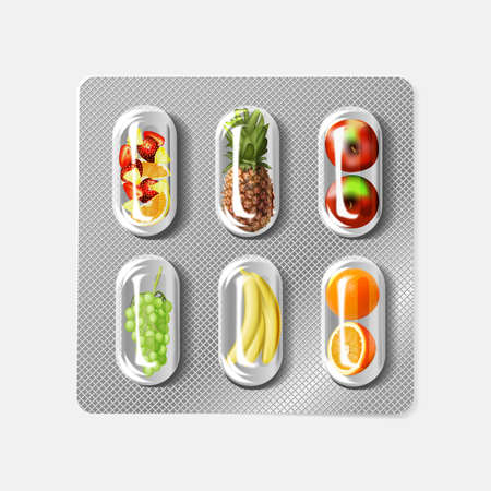 Blister pack of pills with fruit. Vitamins.
