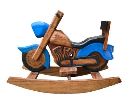 Rocking horse, wooden motorcycle, white background