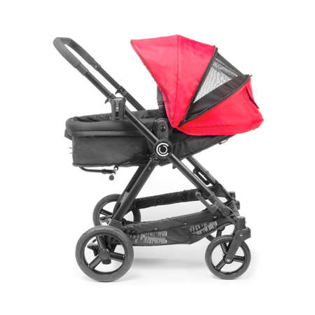 Red Stroller Isolated on White Background. Side View of Baby Transport with Canopy and Swivel Front Wheels. Infant Carriage Seat. Travel System. Pushchair or Pram with Adjustable Showerproof Hood Banco de Imagens