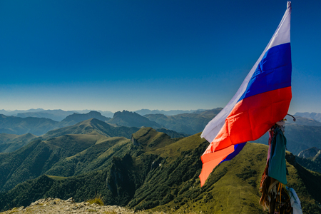 Russian flag on the top of the mountain a Large Thach, North Caucasus, Russia