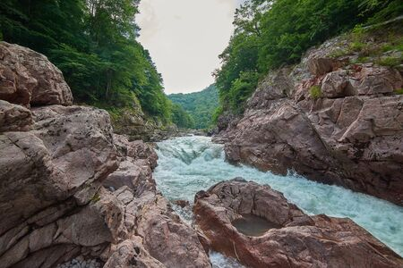 Granite canyon of the river Belaya. Monument of nature. Located in Russia, in the mountains of the North Caucasus. 스톡 콘텐츠