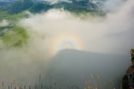 A Brocken spectre, also called Brocken bow or mountain spectre, is the magnified and apparently enormous shadow of an observer cast upon clouds opposite of the Sun's direction. 版權商用圖片