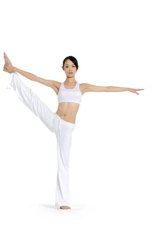 Young asian doing yoga in the  room Stock Photo - 2939869