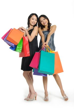 Shopping pretty woman with colored package Stock Photo