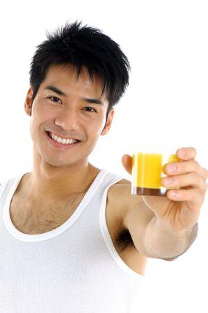 Health Asian holding orange juice