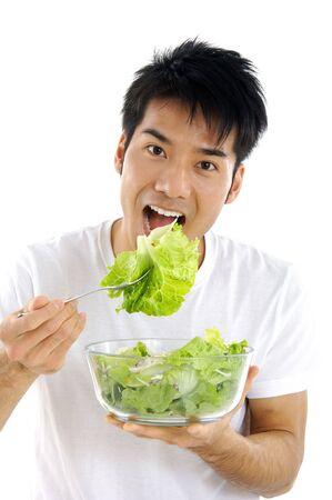 Young Asian man eating Stock Photo