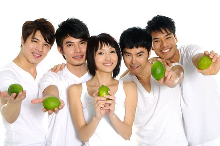 Five Asian young men holding lemons on their hands