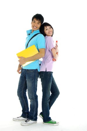 2 Asian young woman and standing with book and bags