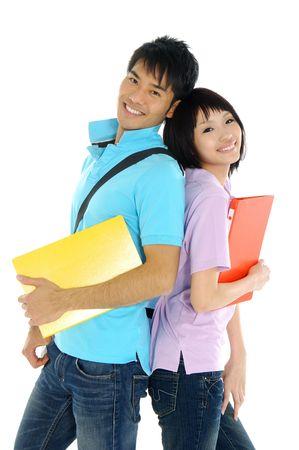 students fun: 2 Asian young woman and standing with book and bags