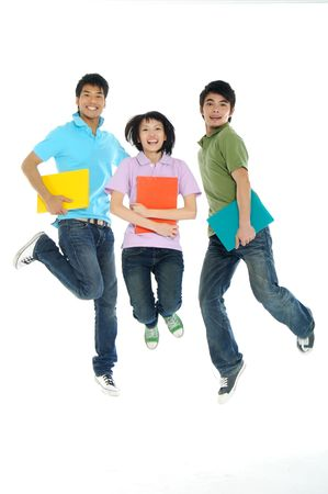 3 Asian happy students jumping the air isolated over a white background
