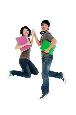 persona saltando: Dos j�venes estudiantes asi�ticos en salto