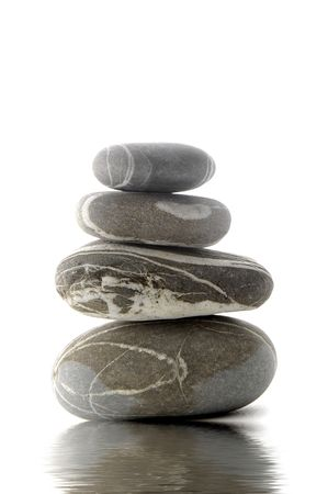 pile of zen stones with reflection