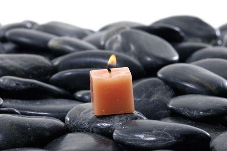 alight: candele accese e ciottoli per la sessione spa