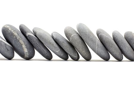 staggered: Pebbles in line on white background Stock Photo