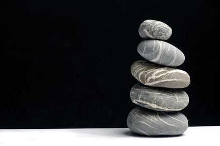 Stack of zen stones on white photo