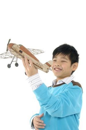 Young boy with toy airplane photo