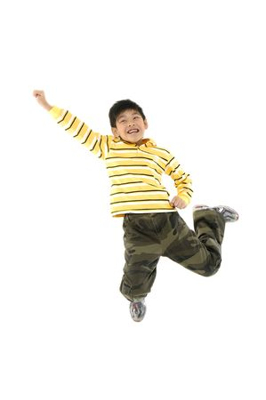 Adorable child jumping a over white background Stock Photo