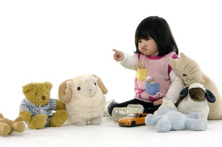 Beautiful little girl in playroom with toys Stock Photo