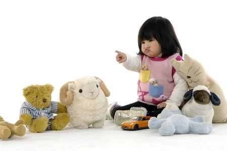 Beautiful little girl in playroom with toys 版權商用圖片