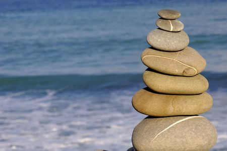 eastern philosophy:  Pebble stack on the seashore Stock Photo