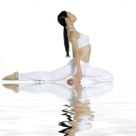 Reflection for beautiful young woman practicing yoga photo