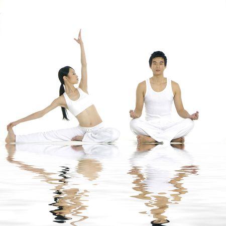 Reflection ofcouple doing yoga exercises together photo
