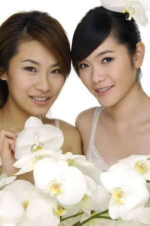 Closeup portrait of beautiful asian woman with white orchids photo