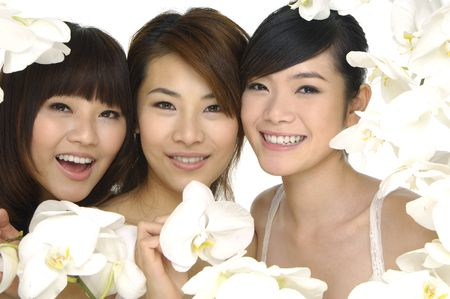 Closeup portrait of beautiful asian woman with white orchids