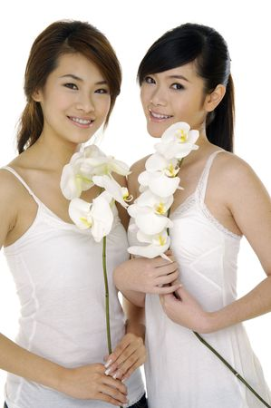 Beautiful girl holding orchid flower in her hands Stock Photo - 6117933