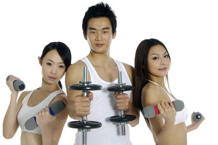 Group of people doing fitness exercise with dumbbells photo