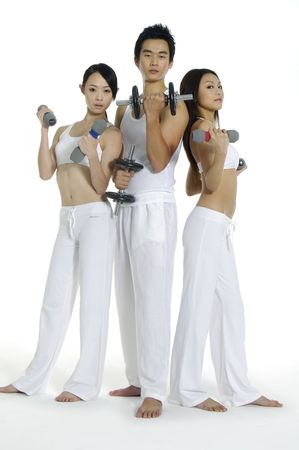 Group of people doing fitness exercise with dumbbells Stock Photo