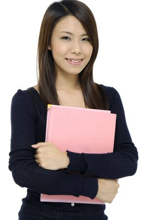 female student portrait smiling and holding a green notebook Stock Photo - 5928714