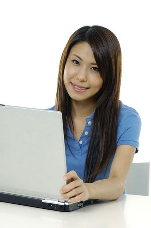 A pretty asian woman working on the laptop Stock Photo - 5928707