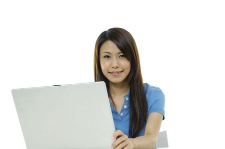 A pretty asian woman working on the laptop Stock Photo - 5928688