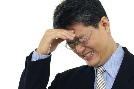 businessman with a big headache Stock Photo