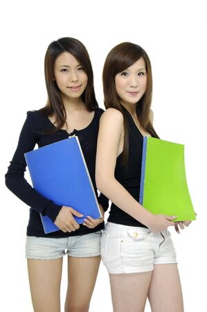 Couple asian young woman carrying notebook photo