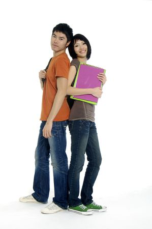 Two students with books and backpacks 版權商用圖片 - 5939167