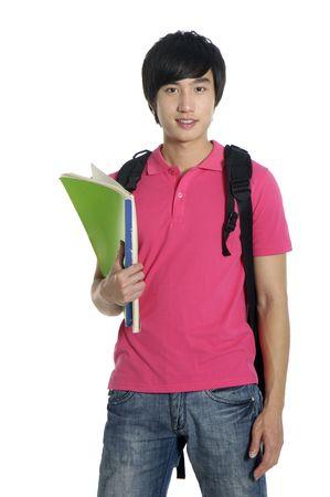 young man standing: Giovane uomo in piedi con il libro e la borsa,