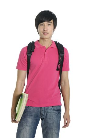 Young man standing with book and bag, photo
