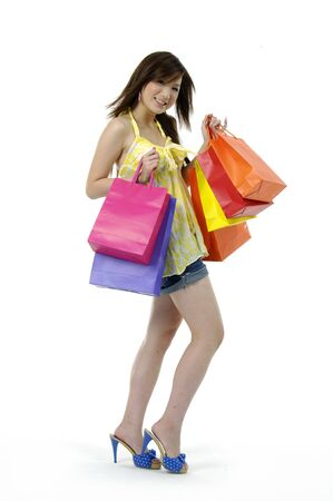 Image of beautiful woman with shopping bags in hand standing in the studio Stock Photo - 5967577