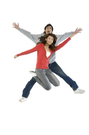 altogether: happy casual couple jumping of joy Stock Photo