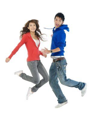 happy casual couple jumping of joy 版權商用圖片