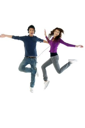 earphone: happy casual couple jumping of joy Stock Photo