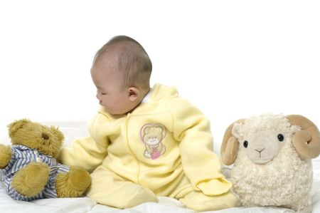 Baby with bear toys and sheep photo
