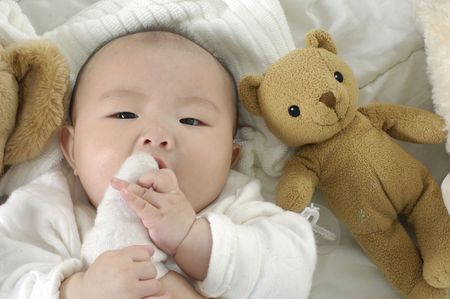 Baby with bear toys